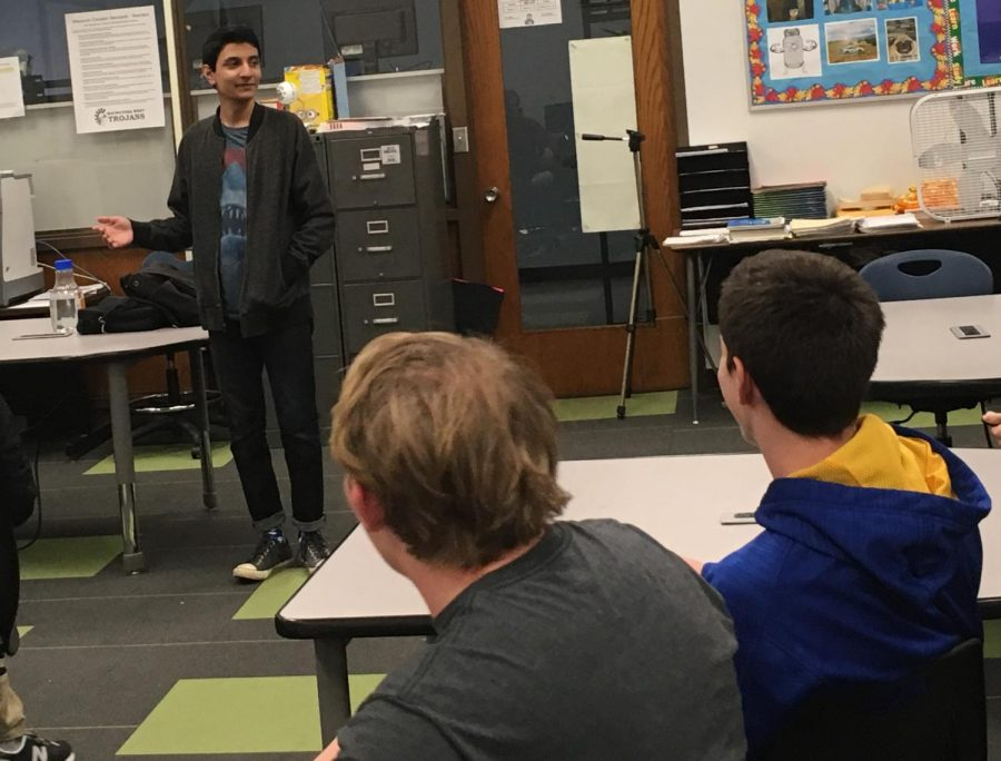 Abdul Bhatti discusses developments installing components on the school computers with the esports club.