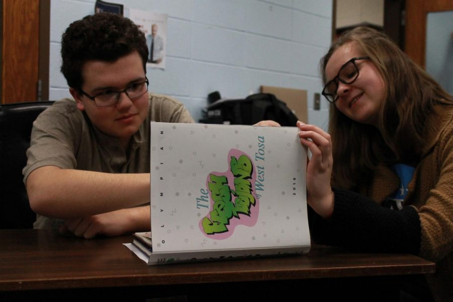 Yearbook Staff Distribute 90's Themed Yearbooks