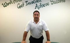 West Principal Frank Calarco stands in front of the inscription on the wall of his office after being first appointed as Principal. Calarco's friend painted the inscription in his office to stress this message to students.