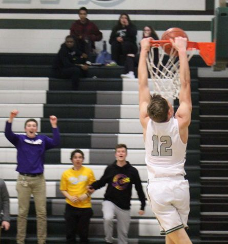 Senior Guard Dylan Parker dunks the basketball at a home game earlier this season.