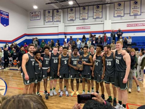 The Wauwatosa West Boys Basketball team with their regional championship trophy after defeating Wisconsin Lutheran 69-49.
