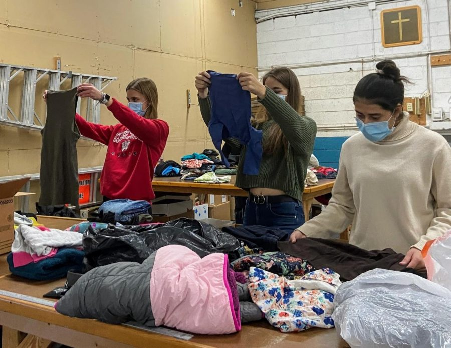 Volunteers+at+Father+Gene%27s+Help+Center+sort+through+donated+clothing+items.+