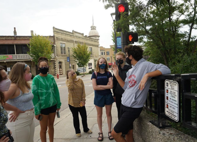 Wauwatosa East Sophomore Henry Dizard preps a group of fellow youth activists before spending the day in the community rallying for racial and climate justice and supporting local candidates.