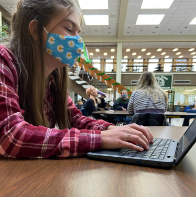 Wauwatosa West Sophomore Lexi Pitcher completes an assignment during her lunch period.