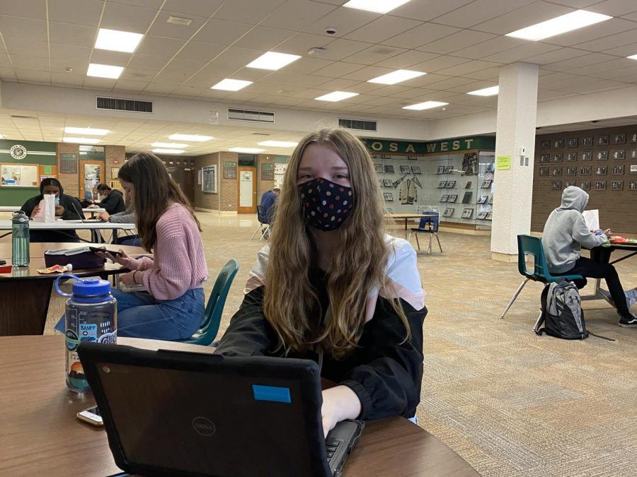 Wauwatosa West freshman Keira Di Castri works on her Chromebook during her lunchperiod.