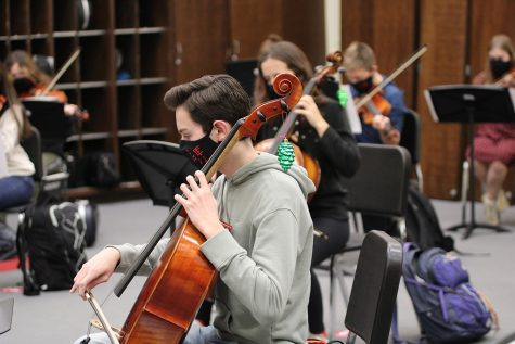 East Senior Aidan Beane plays Sleigh Ride during class, while Mr. Hayden recorded both audio and video. Photo by Sophia Hardman