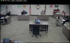 Wauwatosa School Board members met in a hybrid meeting with some members participating in-person and others connecting via the video conferencing platform Zoom on Jan. 25, 2021.