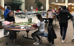 Key Club members wrap gifts in the learning center during the holiday season. The gifts went to families and children in need.