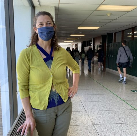 Wauwatosa West math teacher Jill Schmid stands in the hallway near her classroom. Schmid is retiring at the end of the 2020-2021 school year after teaching for 32 years.