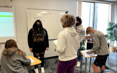 Students from Wauwatosa West's AVID class put their heads together to solve a math problem during their second hour class. AVID has been running trial classes at the highschools for two years. The district has recently decided to expand the program and get more students involved.