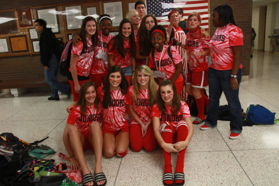 This picture was taken eleven years ago during the homecoming week of 2010. During that year, juniors were red and had to distribute as much red tape as they possibly could.