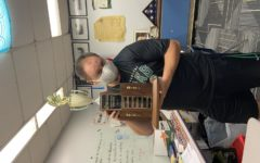 Mr. Mateske poses with the homecoming trophy that has been proudly displayed in his room for the last three years in  a row.
